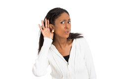 Nosy surprised woman hand to ear secretly listen in on gossip Royalty Free Stock Images