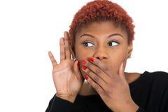 Nosy woman secretly listening conversation Stock Image
