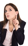 Nosy young woman listening on the door. Concept for news. Stock Photos