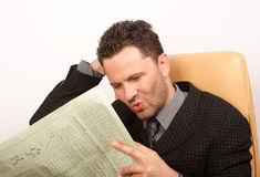 Notícia ruim no jornal Imagens de Stock