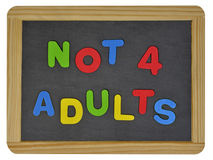 Not for adults in colored letters on slate Stock Photography