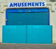 We are not amused. A promenade amusement arcade with a big locked gate Royalty Free Stock Images