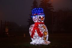 Snowman of lights. Front view, night Stock Photos