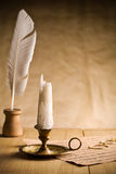Not burning candle on vintage table Stock Images