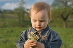 Not children's desires. The child studies to count money Royalty Free Stock Photos