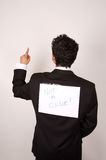 Not a clue. Comic image of young male with humorous sign on his back royalty free stock photography