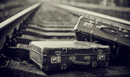 Not the color image of forgotten suitcases on rails. Stock Images