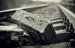 Not the color image of forgotten suitcases on rails. Royalty Free Stock Photo