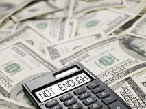 Not enough. Calculator with inscription on dollars background Royalty Free Stock Photography
