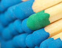 Not enough blue as others. Close-up shot of blue group matches and single green Royalty Free Stock Image