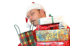 Not enough hands. Man carrying so much presents that he needs to carry some in his mouth royalty free stock photos
