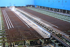 Not equal sides Angle steel in a production line Stock Photography