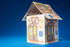 Not expensive. House made out of  50 Euro bills Stock Photos