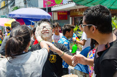 Not the face!. Bangkok, Thailand, 14 April 2015. Young people smear mud on each other's faces at Khao San Road during the Songkran street party. The annual Royalty Free Stock Image