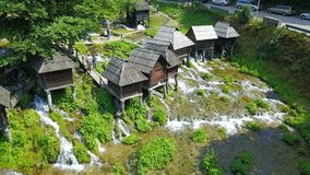Watermills on the river Pliva. Not far from the town of Jajce, between large and small lake on Pliva, on the sedge barrier there are built watermills - Plivske Stock Photos