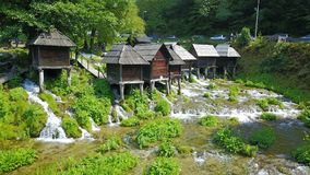 Watermills on the river Pliva. Not far from the town of Jajce, between large and small lake on Pliva, on the sedge barrier there are built watermills - Plivske Stock Photography