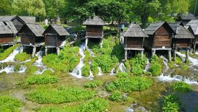 Watermills on the river Pliva. Not far from the town of Jajce, between large and small lake on Pliva, on the sedge barrier there are built watermills - Plivske Royalty Free Stock Photo