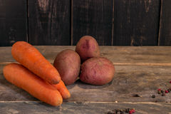 Not fresh potato and carrot on wood . Vegetables on vintage wood. En planks Royalty Free Stock Image