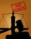 Not Guilty verdict. Court gavel and scales of justice with Not Guilty stamp royalty free stock photos