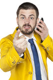 Not happy businessman talking on the phone and threatens finger Stock Photo