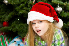 Not a happy girl. Girl with a frown on her face during christmas time Royalty Free Stock Photography