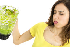 Not happy about the green smoothie Stock Image