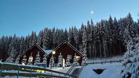 Evening tale snow-capped mountains, the magnificence of the Ukrainian Carpathians and Bukovel resort on Christmas Day. Is it not here that Santa Claus and his stock images