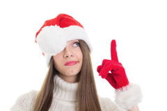Not impressed girl with Santa beanie pointing and looking up Stock Photos