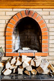 Not kindled brick fireplace and wood logs Royalty Free Stock Photo