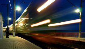 Not late. Electric train with trail of headlight light Stock Image