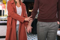 Loving tender couple holding hands stock photos