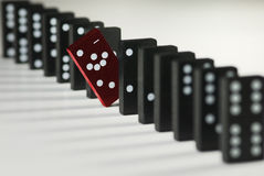 Not like the others. Symbolized difference with simple domino tokens Royalty Free Stock Images