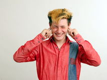Not listening guy with golden hairstyle in the red Royalty Free Stock Images