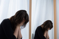 Not looking in the mirror. Young woman with depression not looking in the mirror Stock Photography