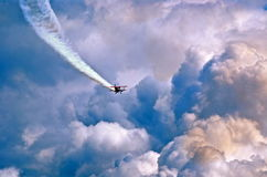 Not Lost Just Exploring. Blue clouds lone plane in flight dreamscape atmosphere newver give up searching or trying to succeed Royalty Free Stock Photo