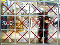 Not much allowed. A sign on a glass wall in a shopping mall in Budapest, Hungary. Not much is allowed here Royalty Free Stock Photography