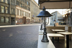 Not opened cafe in the morning in the old European city. Stock Photo
