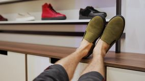 This is not place for your legs. POV, this is not place for your legs, foot with boots on a table in shop stock footage