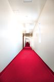 The not so red carpet. Red carpet in a hallway Royalty Free Stock Image