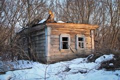Not residential half-ruined wooden house on the outskirts of the village royalty free stock photography