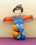 Not So Scary Scarecrow Sitting Down Royalty Free Stock Photography