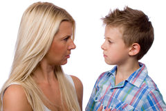 Not scold me, Mom. Beautiful young mother with blond hair and a little boy in a shirt Royalty Free Stock Image