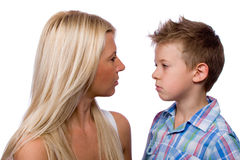 Not scold me, Mom. Portrait of a beautiful woman and young boy Stock Photography