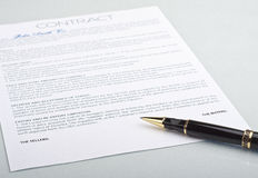 Not signed a contract with a pen. On a light background Royalty Free Stock Photography