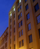 Not sleeping building. The building at night with a light in a window Royalty Free Stock Photography