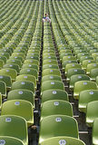 Not sold out. One single person in a football stadium Stock Image