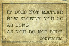 Not stop Confucius. It does not matter how slowly you go - ancient Chinese philosopher Confucius quote printed on grunge vintage cardboard Royalty Free Stock Images
