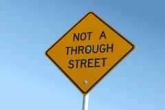 Not a through street sign. A road sign shot from a low angle reads Not a through street stock image