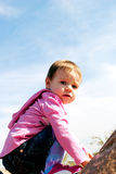 Not so sure about this. A baby girl scared on a mountain Stock Photography