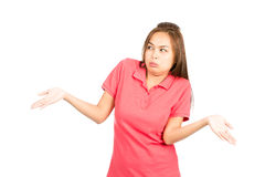 Not Sure Asian Woman Shoulders Shrugging Hands Up. Unsure and indifferent Asian woman dressed in casual clothes, frowning, throwing hands up, shrugging shoulders Royalty Free Stock Photos